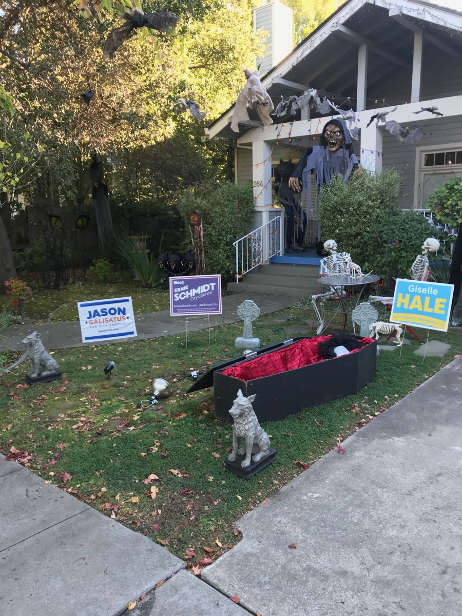 im starting to see halloween decorations popping up around the city some juxtaposed rather interestingly with signs from our upcoming city council